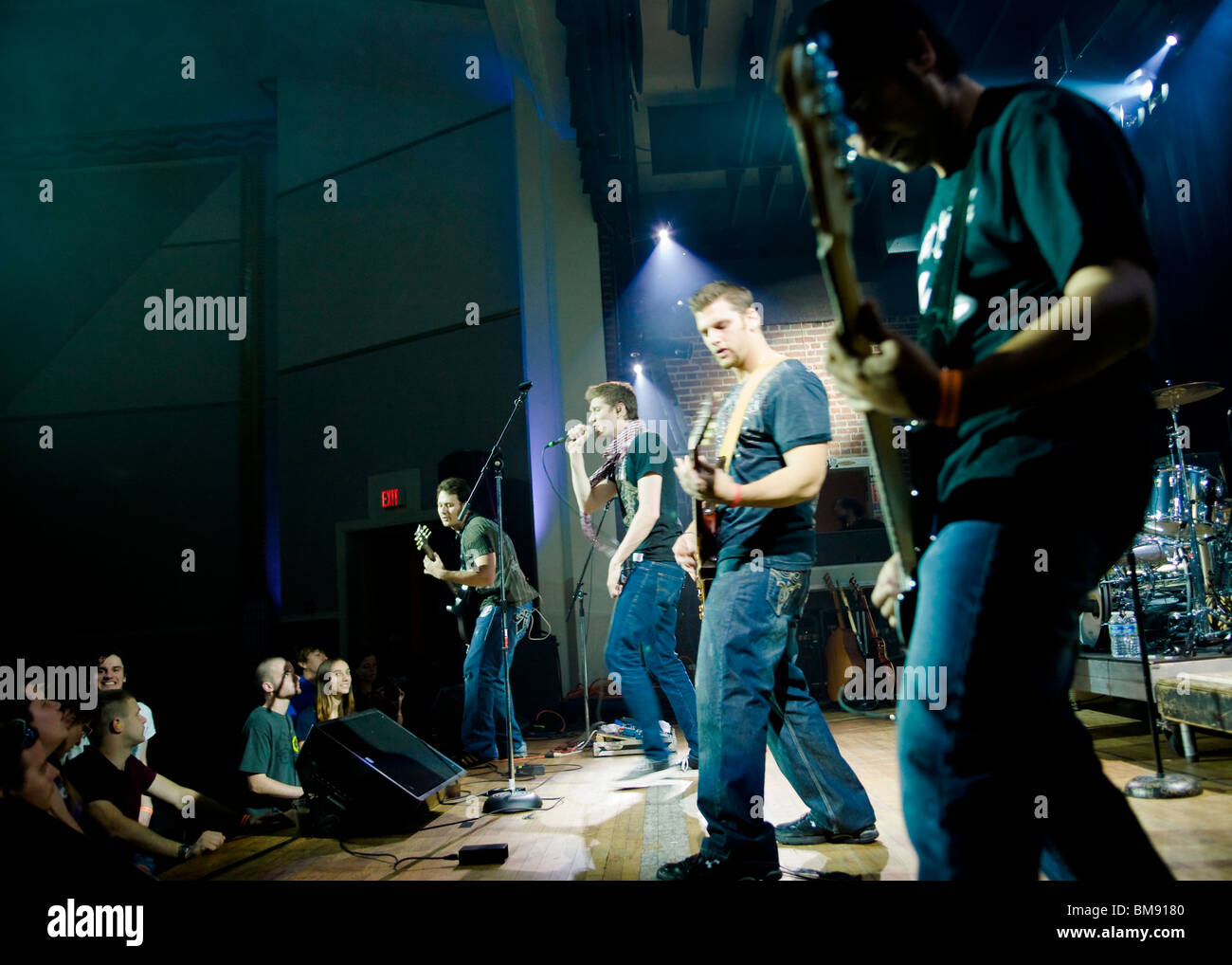 Rock band playing on stage - Stock Image