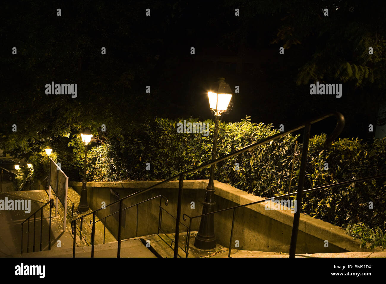 France, Paris, Montmartre, stairs lit by street lamps at night - Stock Image