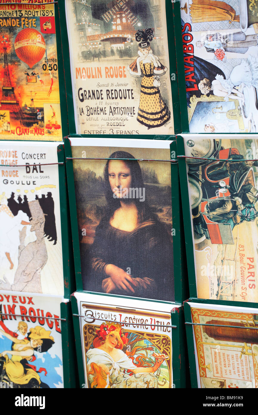 Poster of Mona Lisa in the middle of other posters. Montmartre, Paris. - Stock Image