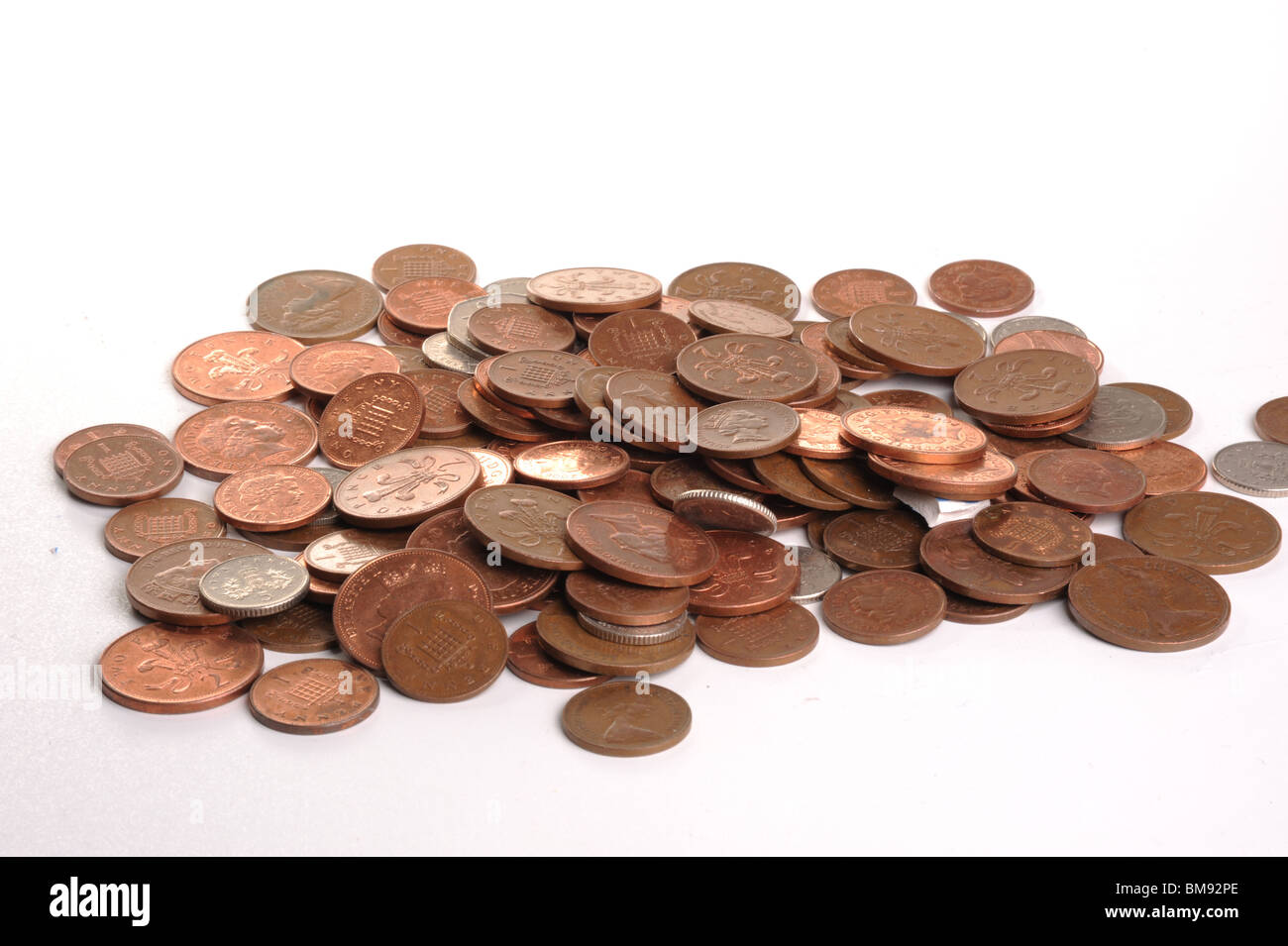 Small change photographed in studio on a plain background - Stock Image