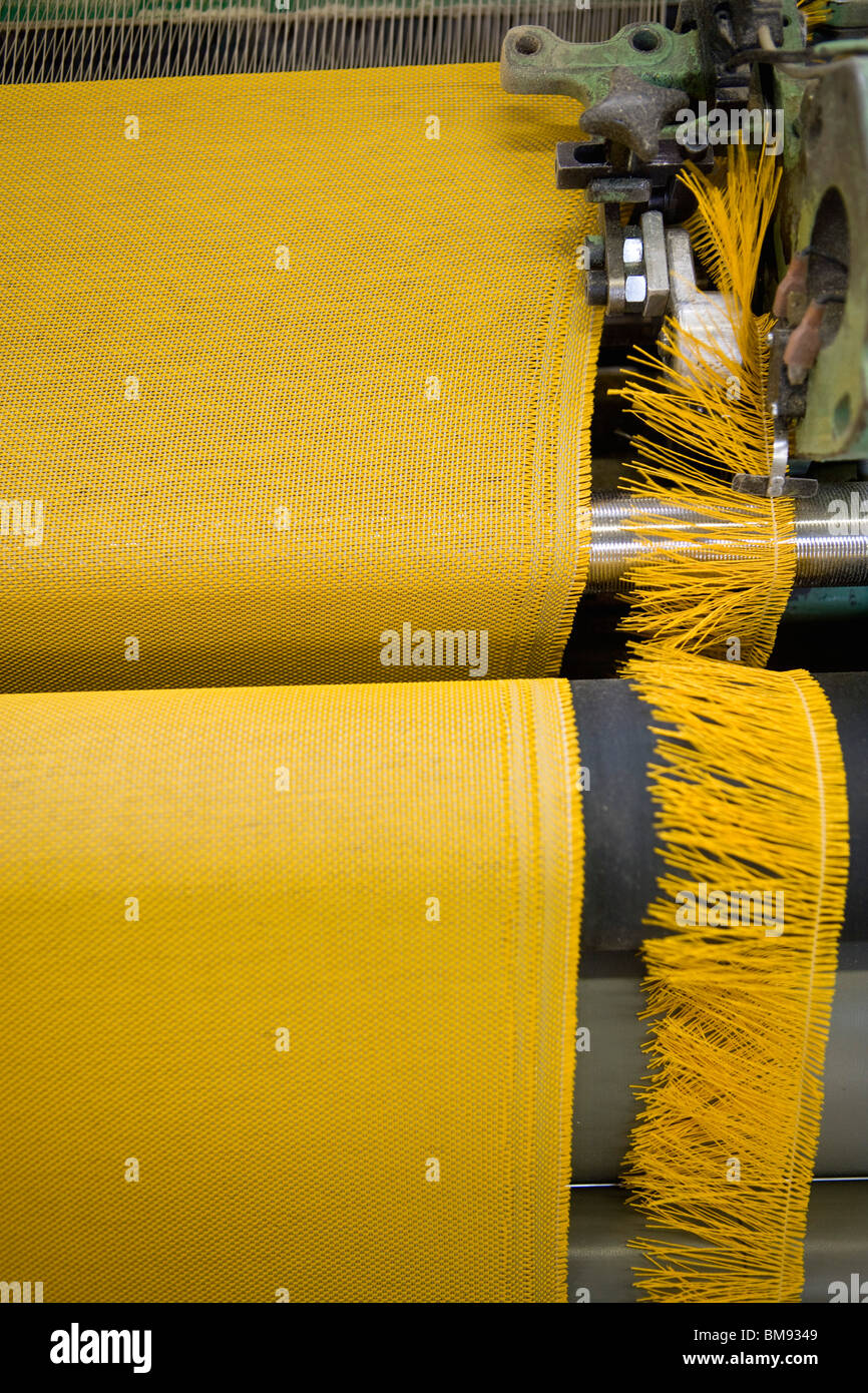 Fabric coating plant, weaving department, textile composite fabric selvage - Stock Image