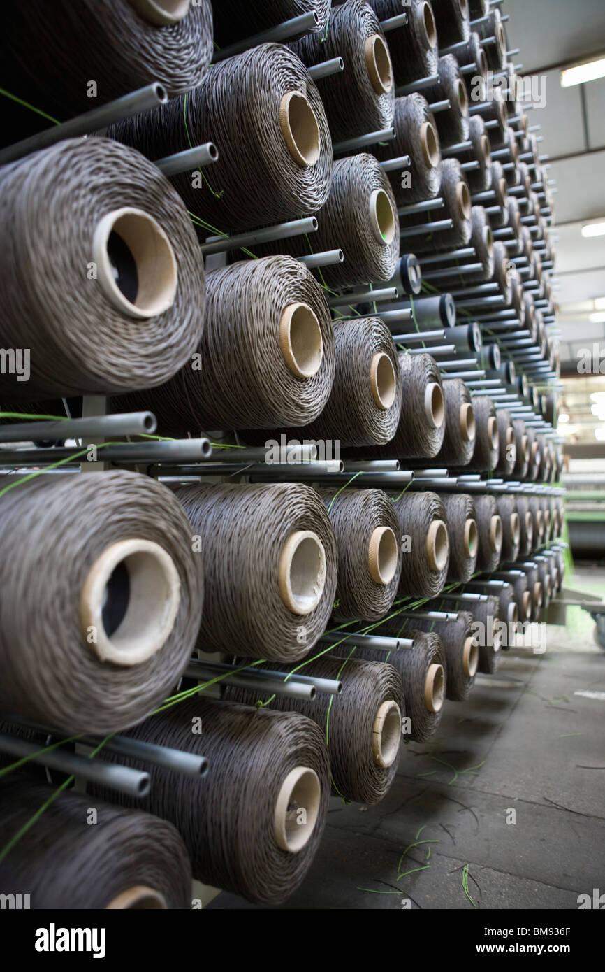 Fabric coating plant, weaving department, unwinding creel - Stock Image