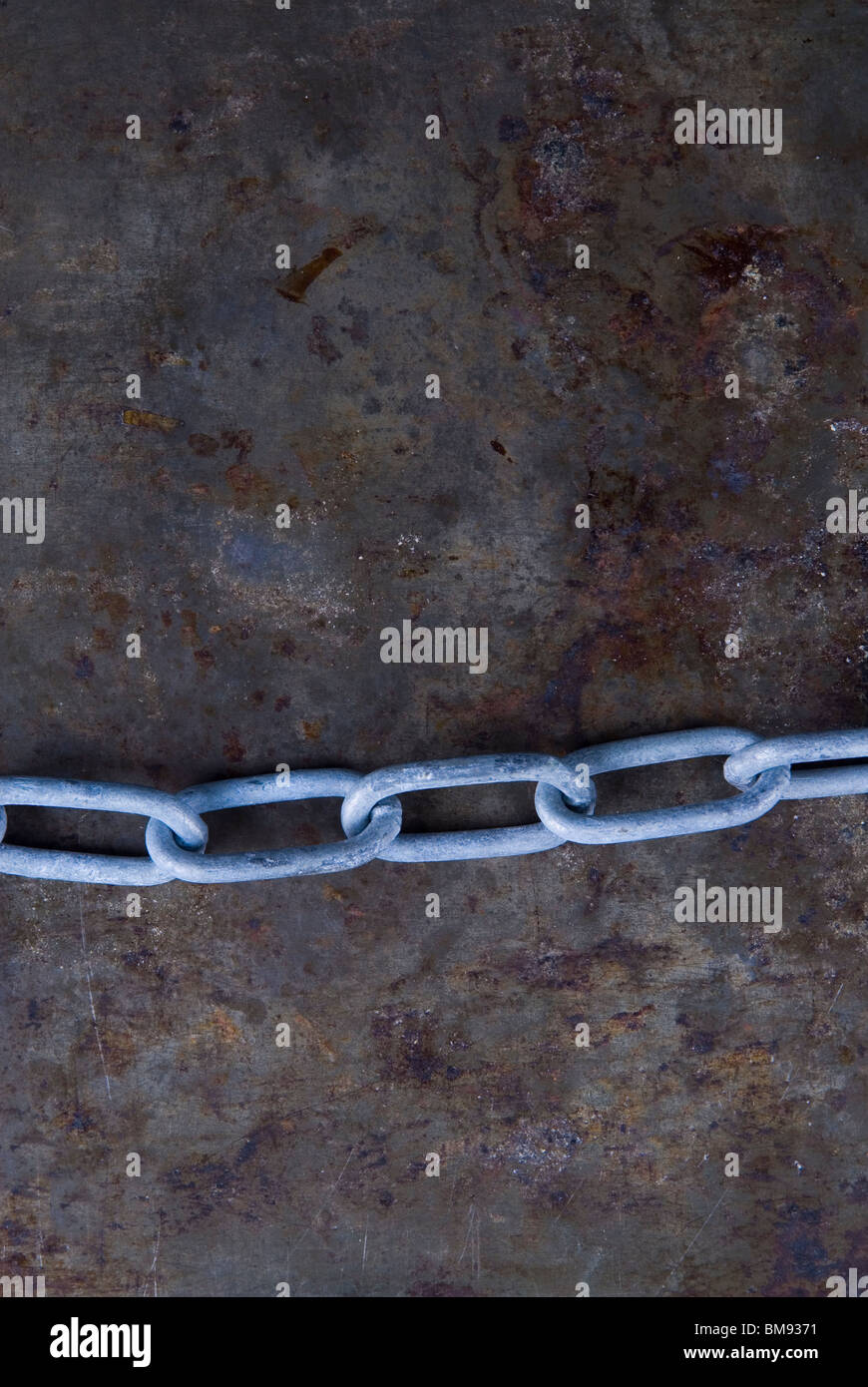 Closeup of a metal chain links - Stock Image