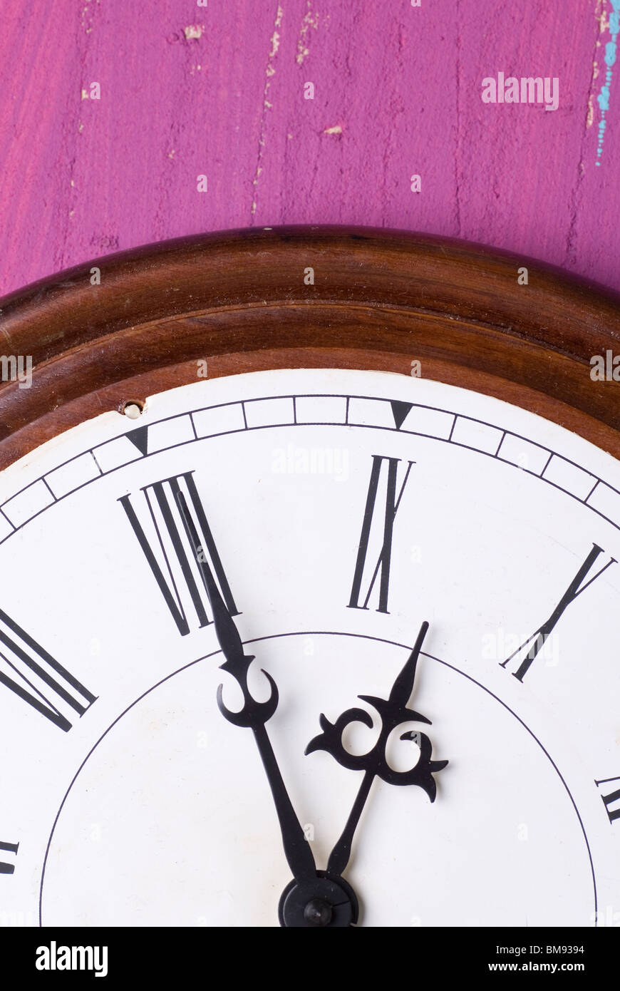 Closeup of an old wall clock - Stock Image