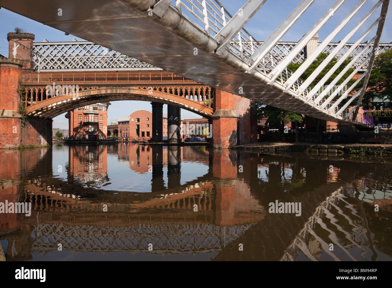 Merchant's Bridge and old railway bridge over Bridgewater Canal basin in Castlefield Urban Heritage Park conservation - Stock Image
