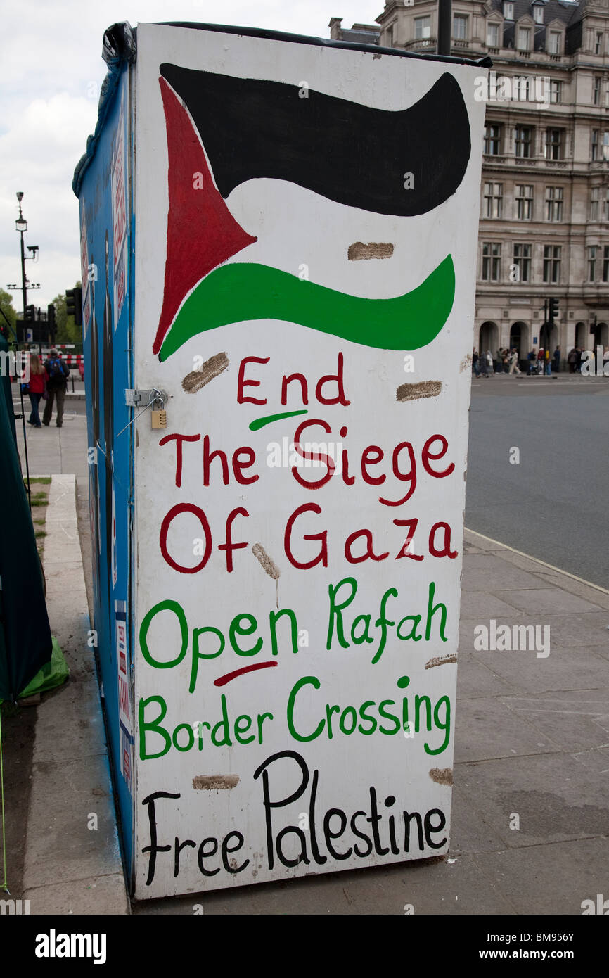 A 'Free Palestine' peace protest poster, Parliament Square, London, England. - Stock Image