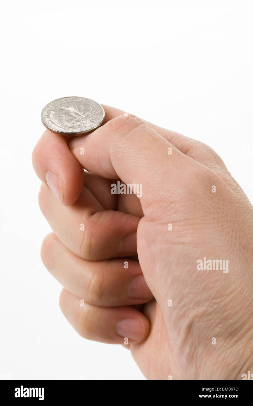 flipping coin close up shot, concept of Decision Stock Photo