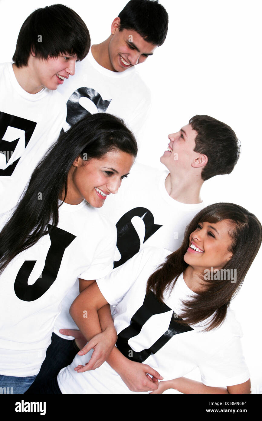 Five Teenagers With T-Shirts Spelling Jesus - Stock Image