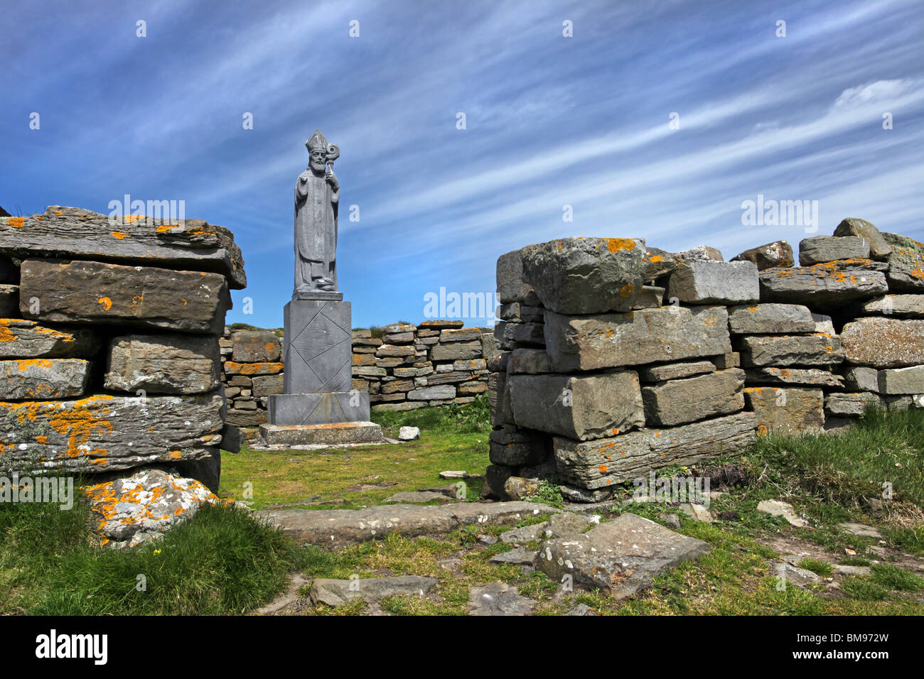 St Patrick's statue on the ruins of an old church at Downpatrick Head, Co Mayo, Ireland. - Stock Image