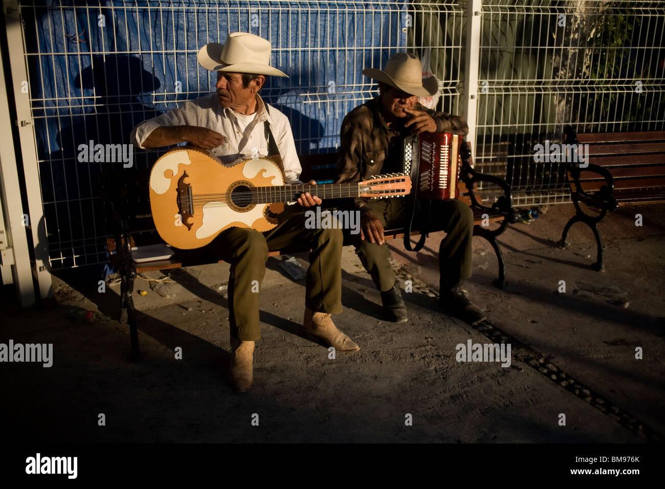 Musicians wait for customers during Nino Fidencio celebrations in Espinazo, Nuevo Leon state, Mexico, March 19, - Stock Image