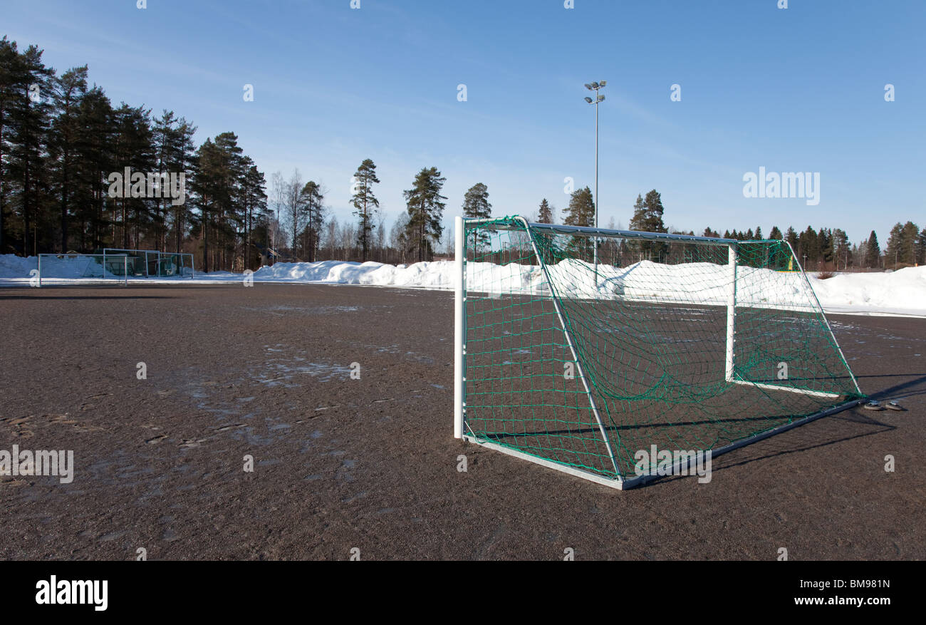 Soccer goal on an empty wet and muddy pitch , Finland - Stock Image