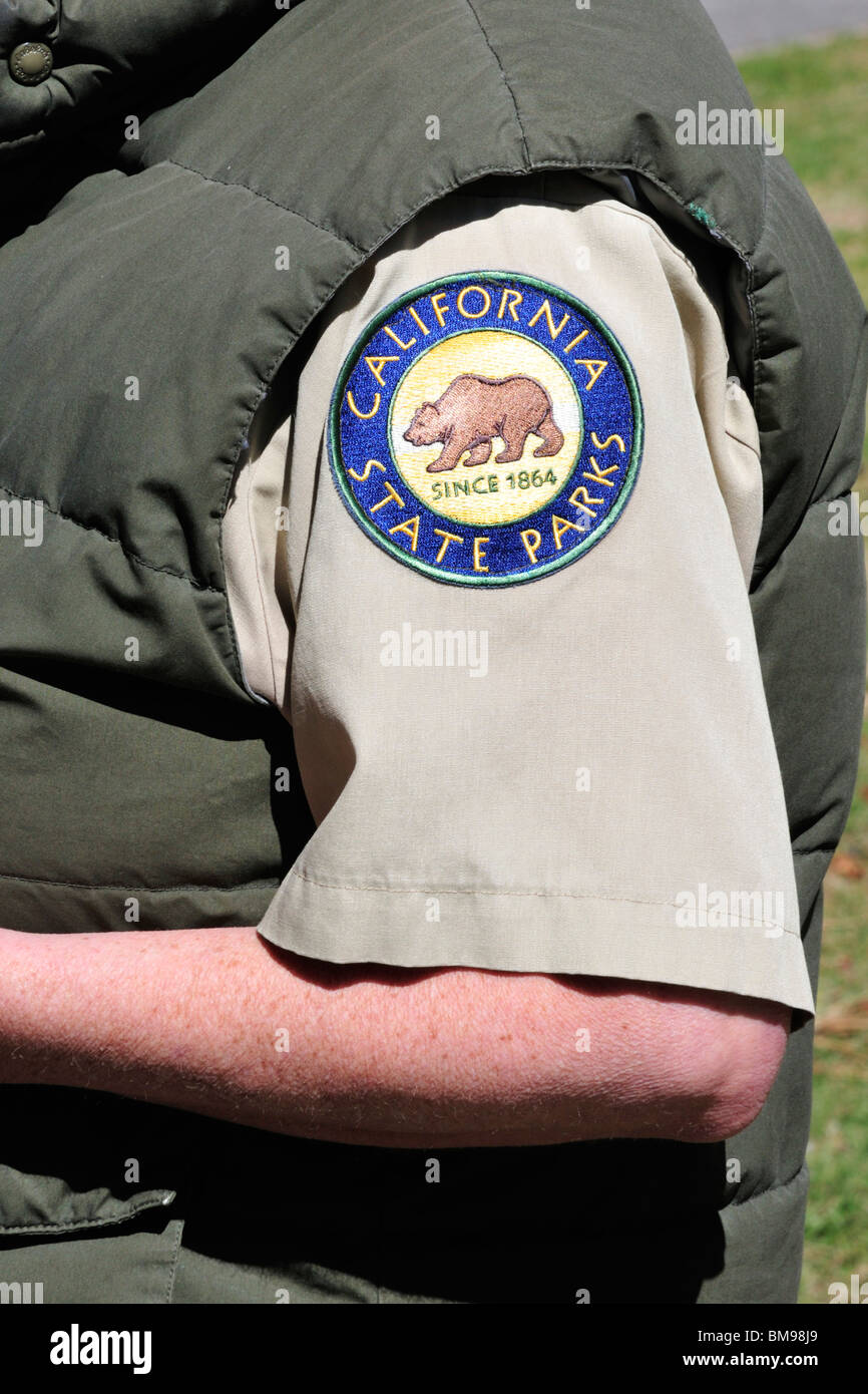 California State Parks insignia on the arm of a park employee - Stock Image