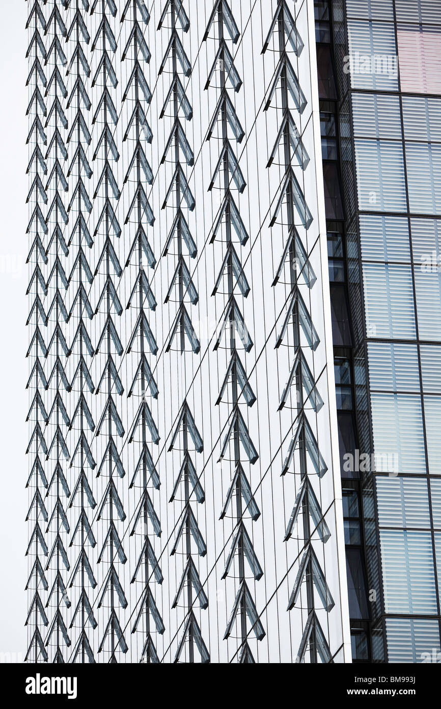 Rows of open windows on the Manitoba Hydro office tower, Winnipeg, Manitoba, Canada - Stock Image
