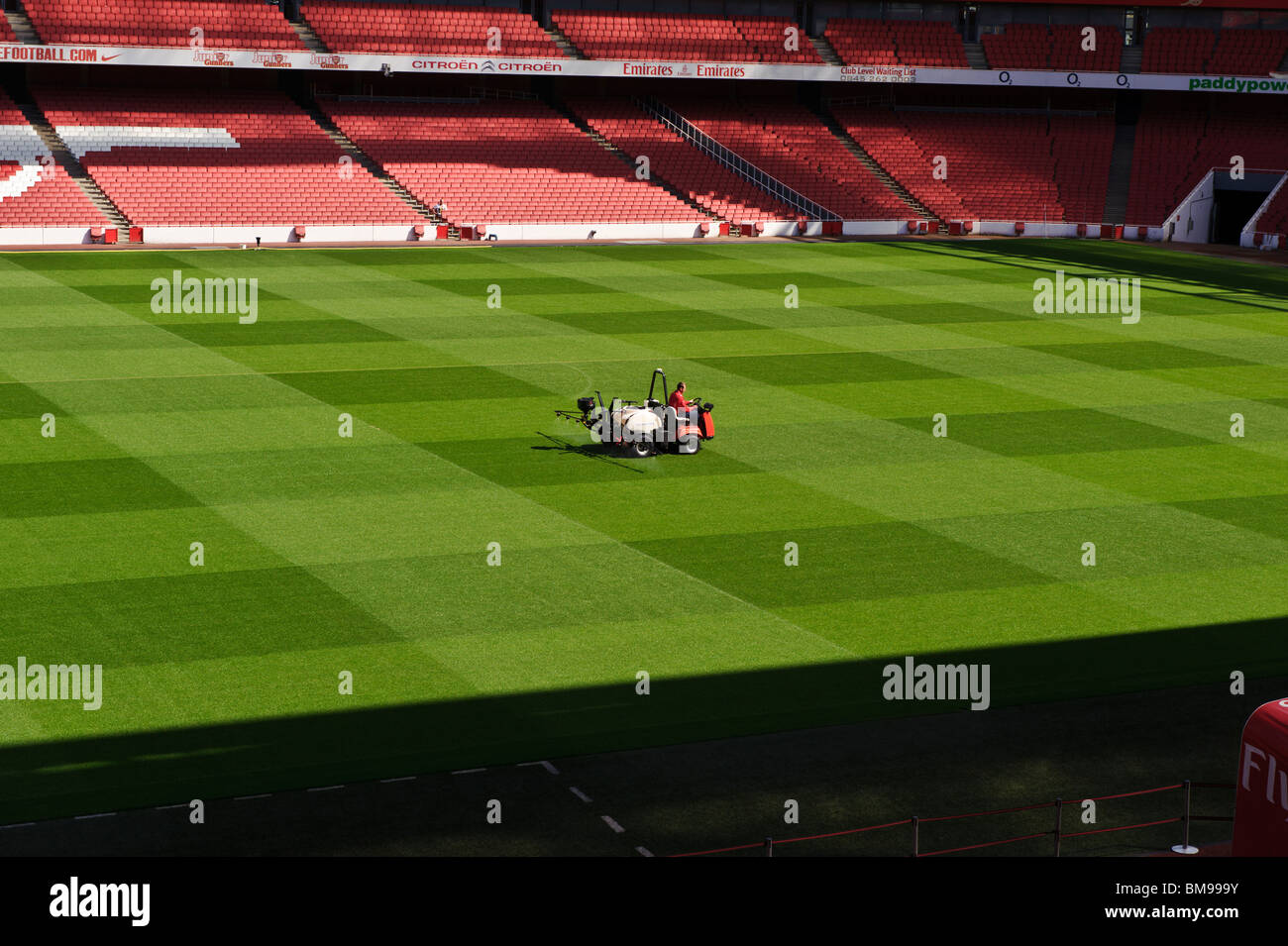 The Emirates Stadium, Arsenal football club, English Premier football soccer league. The pitch is being watered. - Stock Image