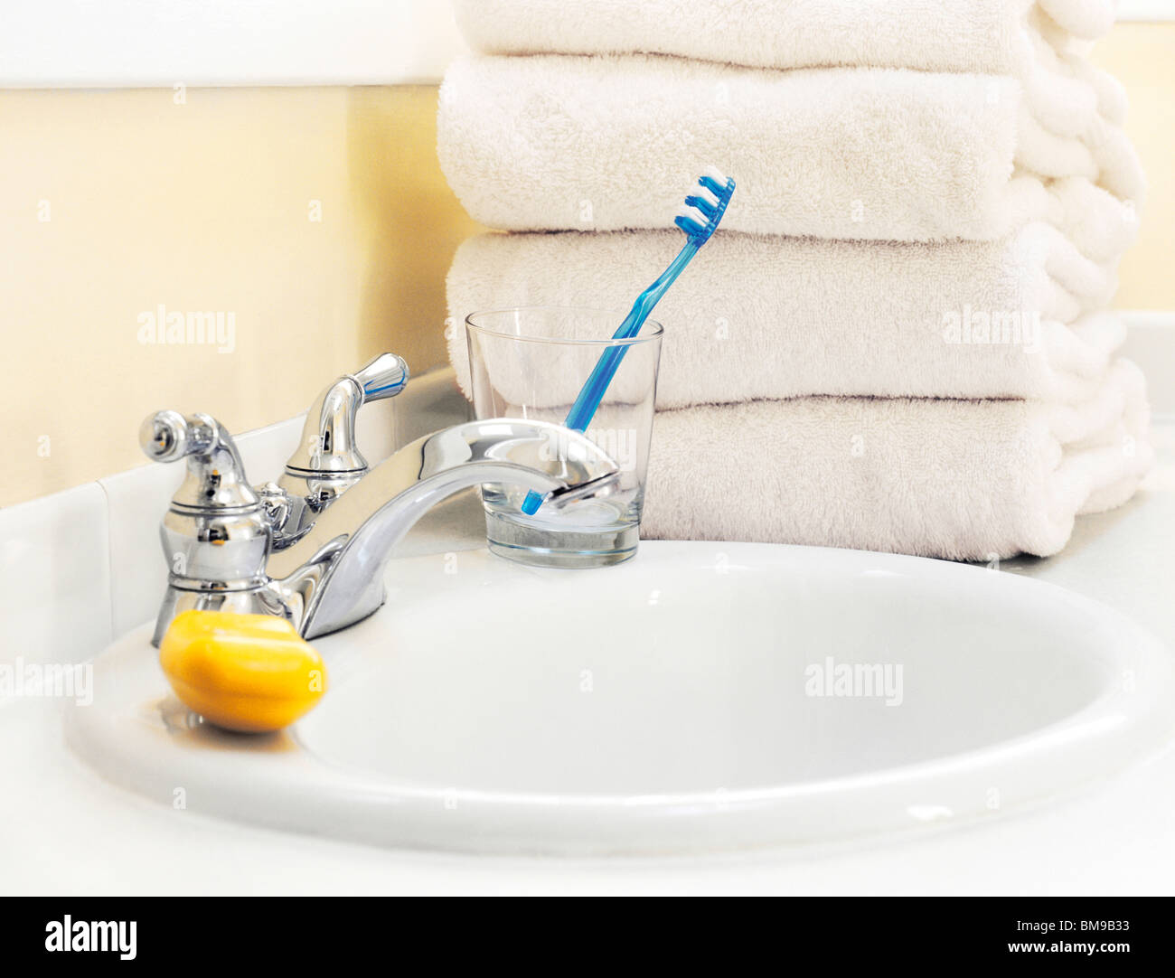 Close-up View of Bathroom sink and towels - Stock Image