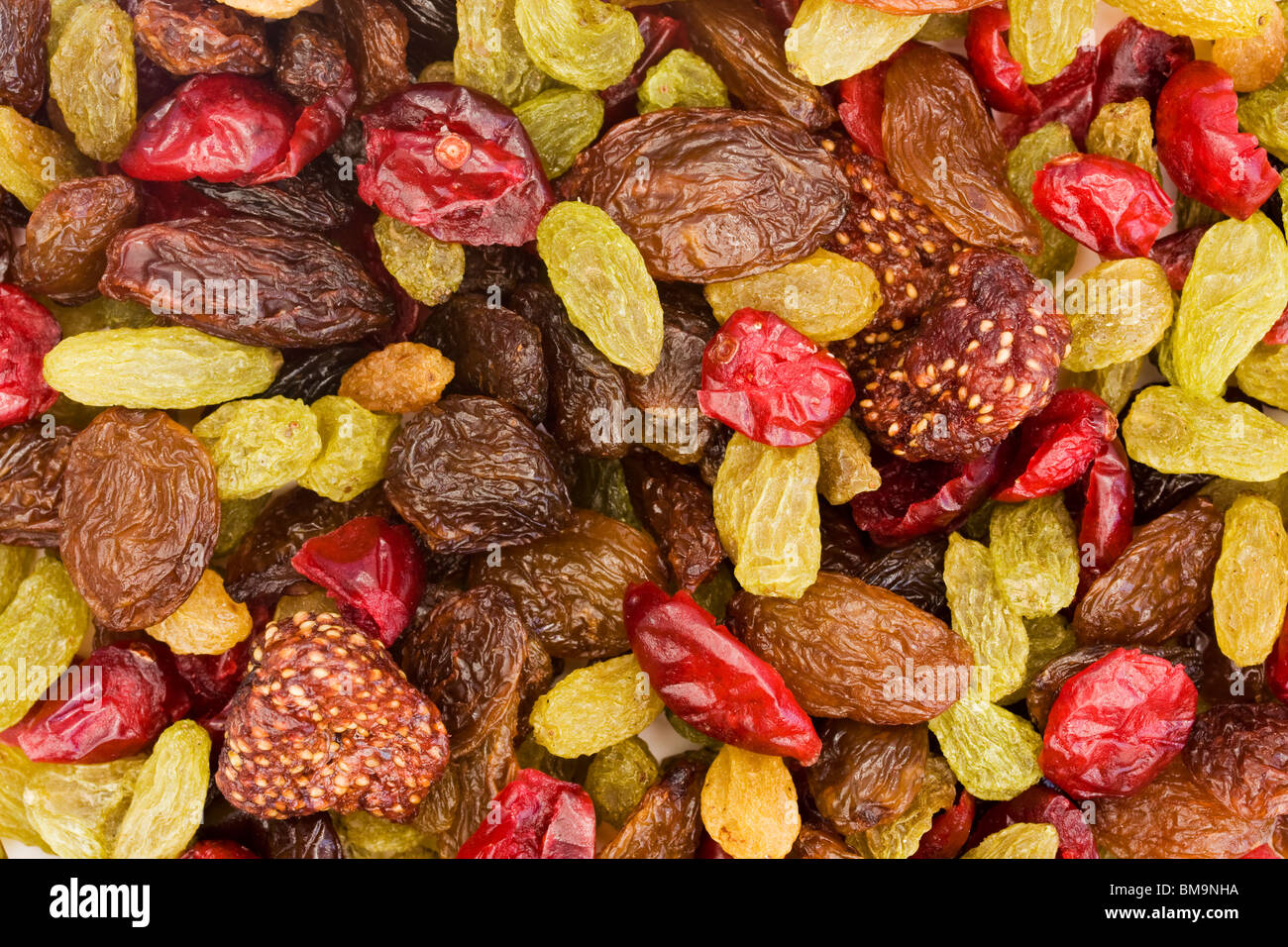 background of assorted dried fruit mix - Stock Image