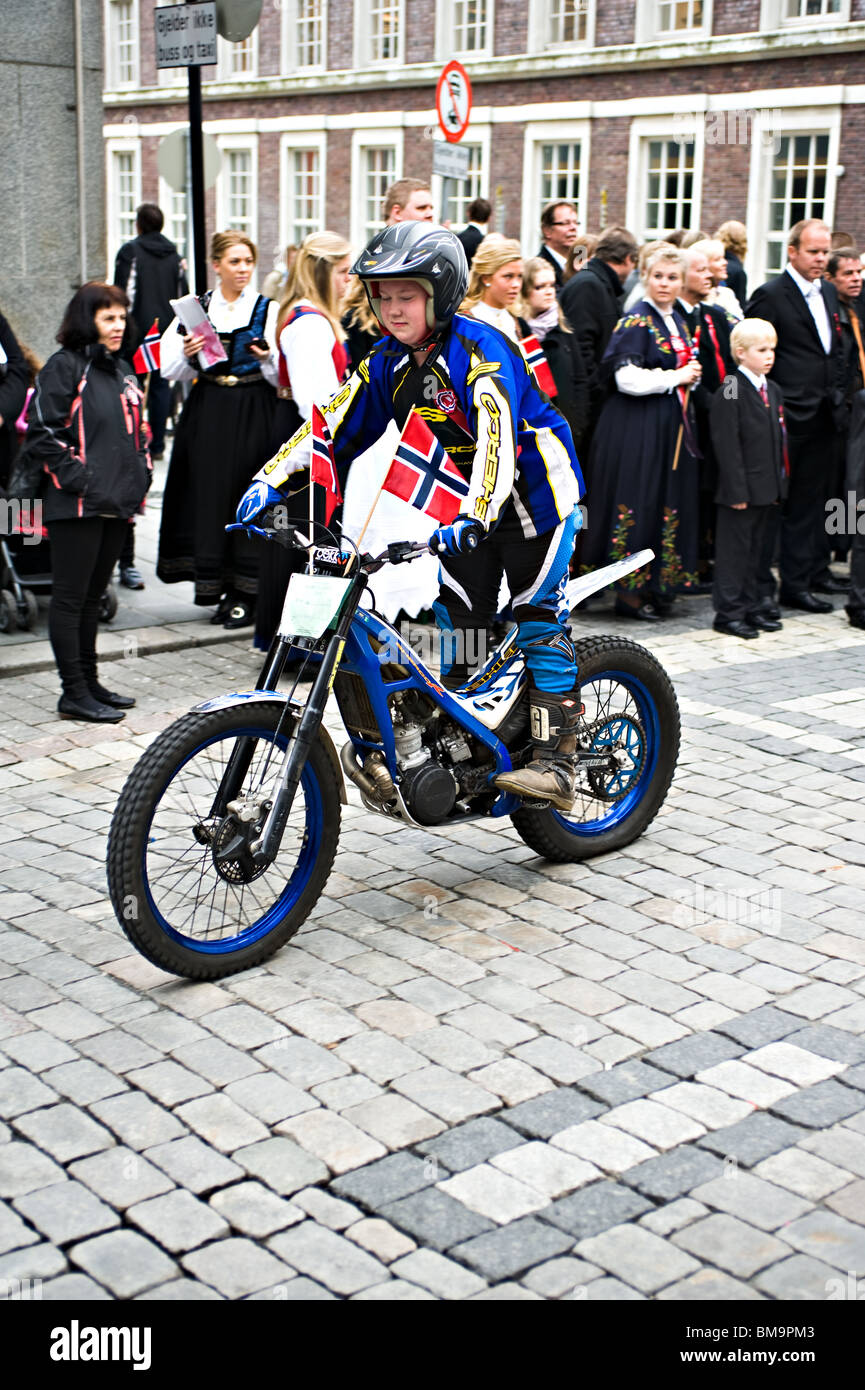 Young Boy on a Motor Cycle Scrambling Bike in the Annual Constitution Day Parade in Bergen Norway Stock Photo