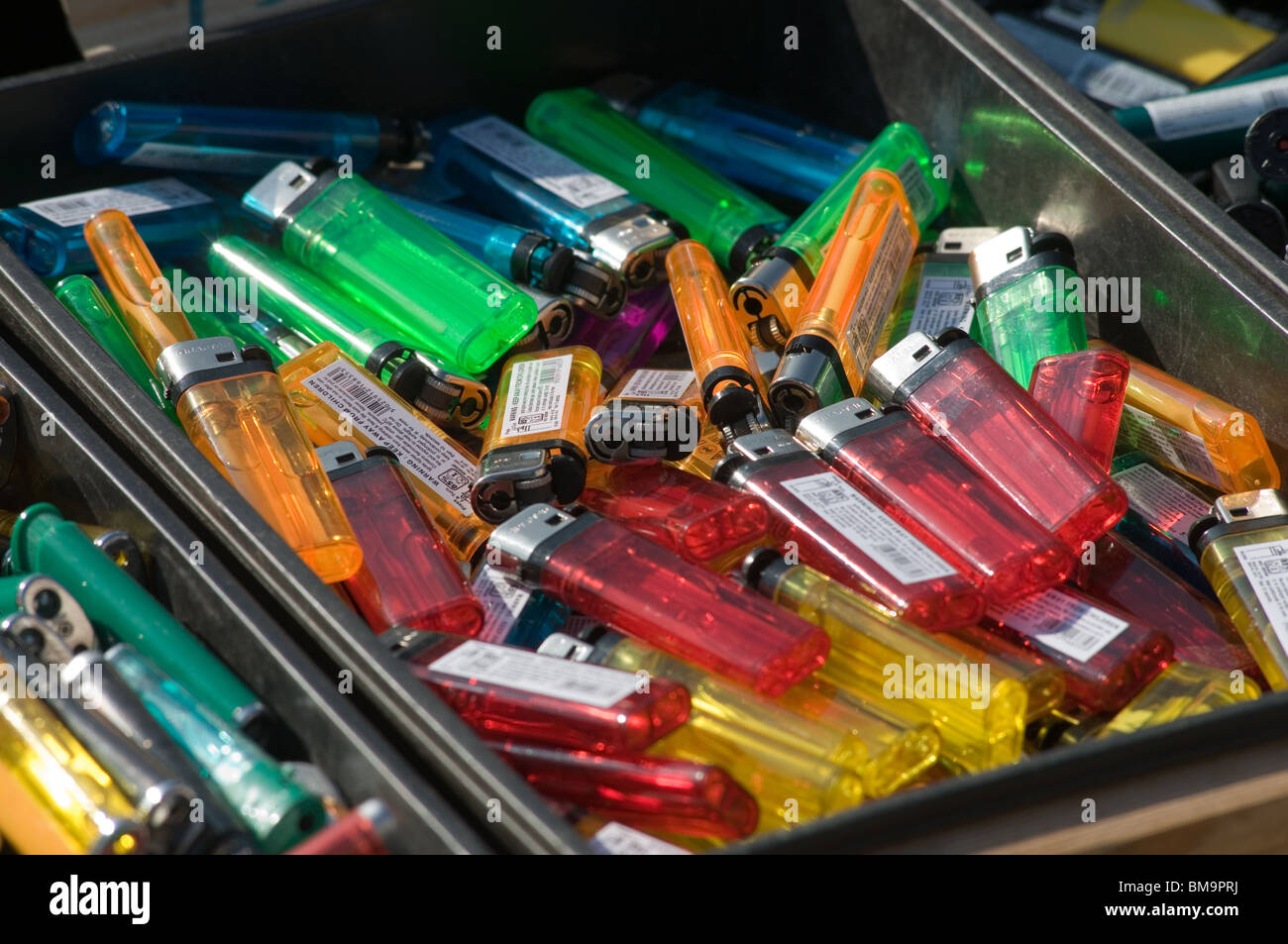 cigarette lighter lighters fag fags cigarettes plastic disposable bic gas flint flints throwaway throw away fire - Stock Image