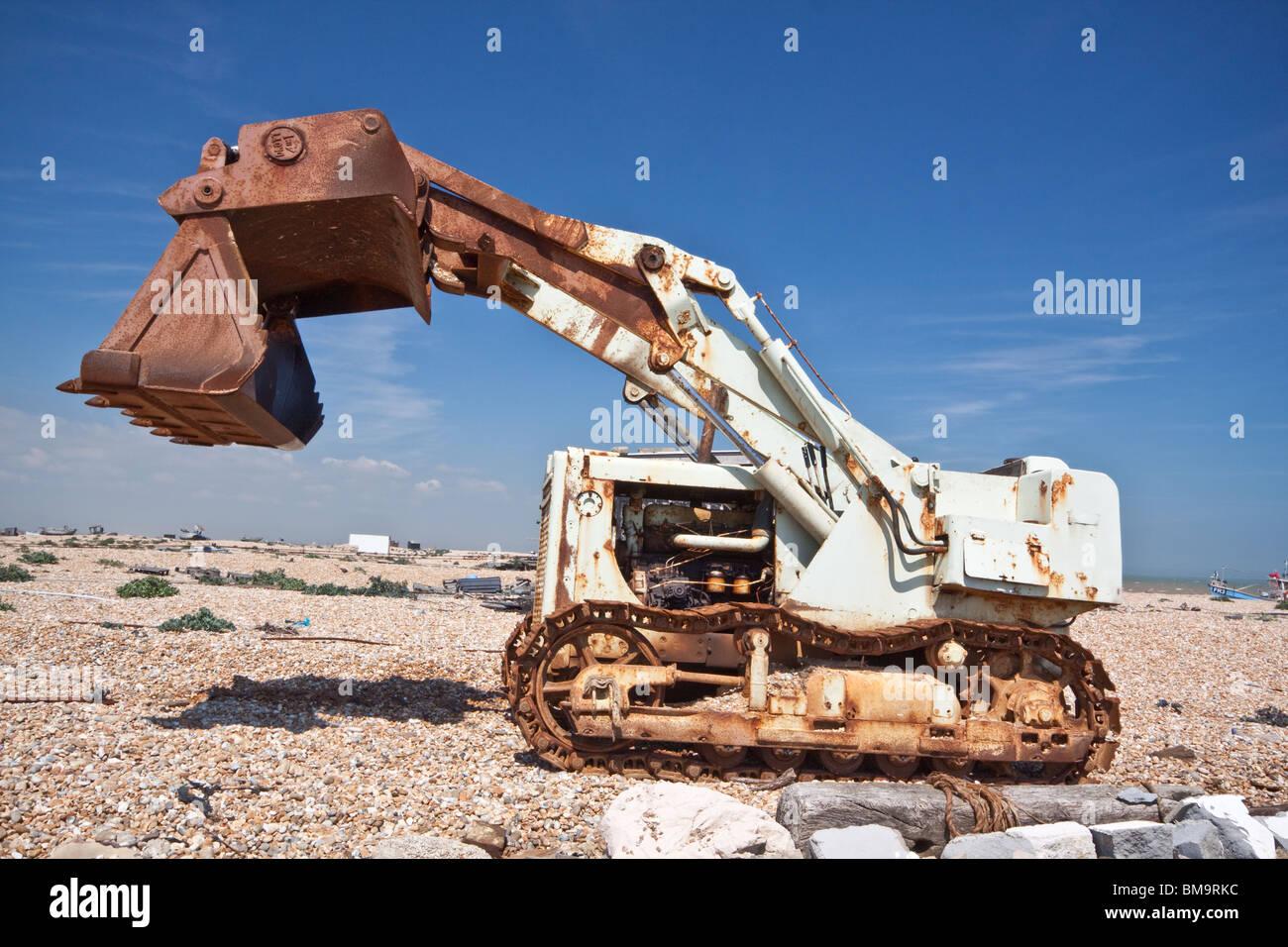 Caterpillar Bulldozer Tractor on Dungeness Beach - Stock Image