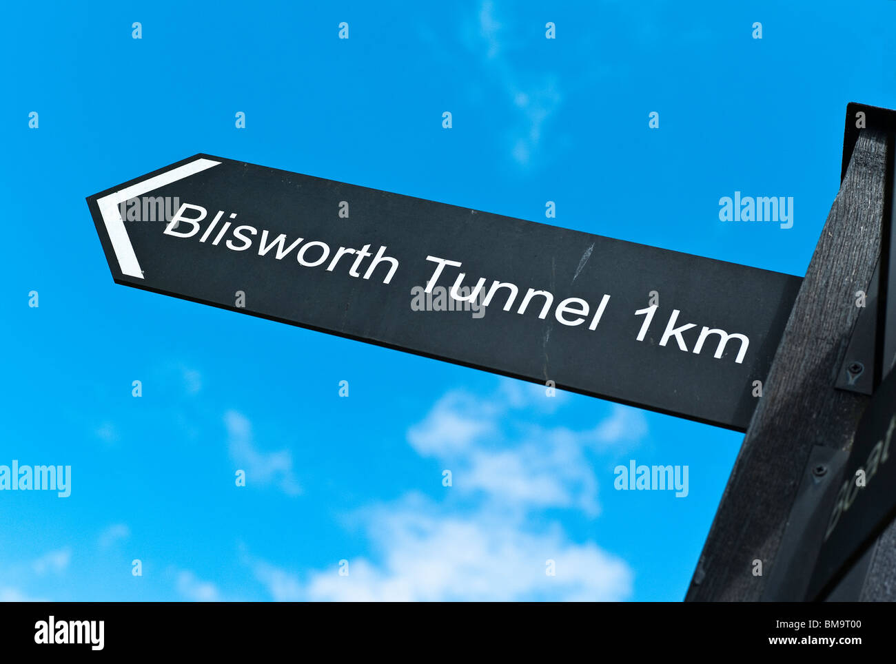 Sign by canal at 'Stoke Bruerne' showing distance to Blisworth tunnel - Stock Image