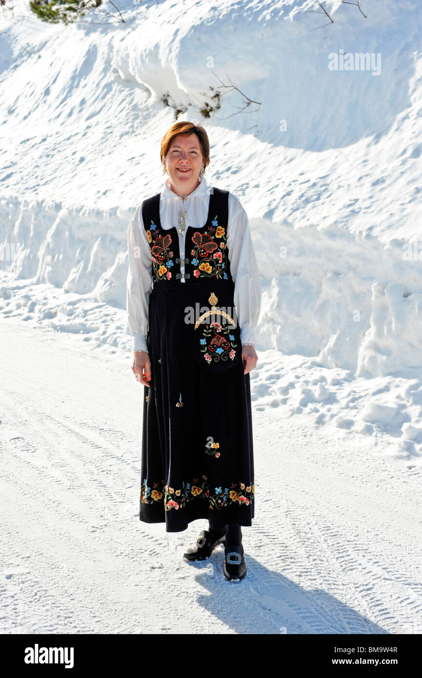 Local woman in Norwegian National Costume on a winters day Stock Photo