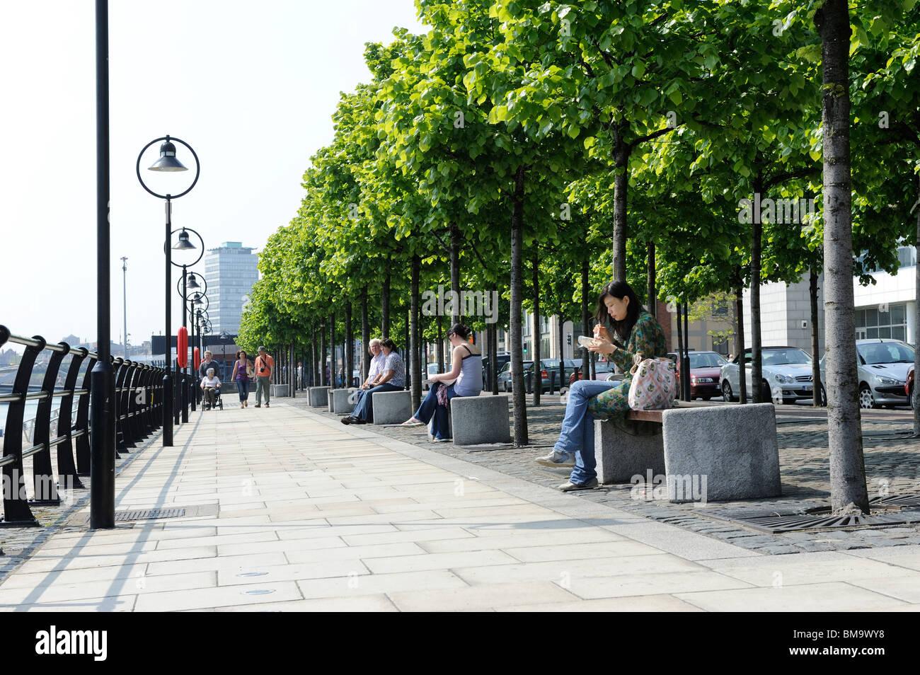 Pedestrian Walk alongside the river Liffey in Dublin City, Ireland - Stock Image