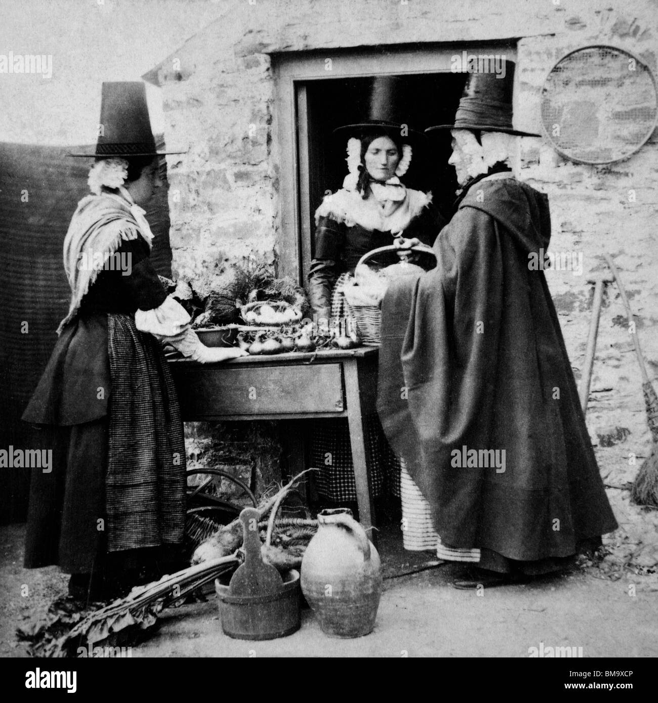 Wales, Welsh women wearing traditional national costume in mid Victorian market scene - Stock Image