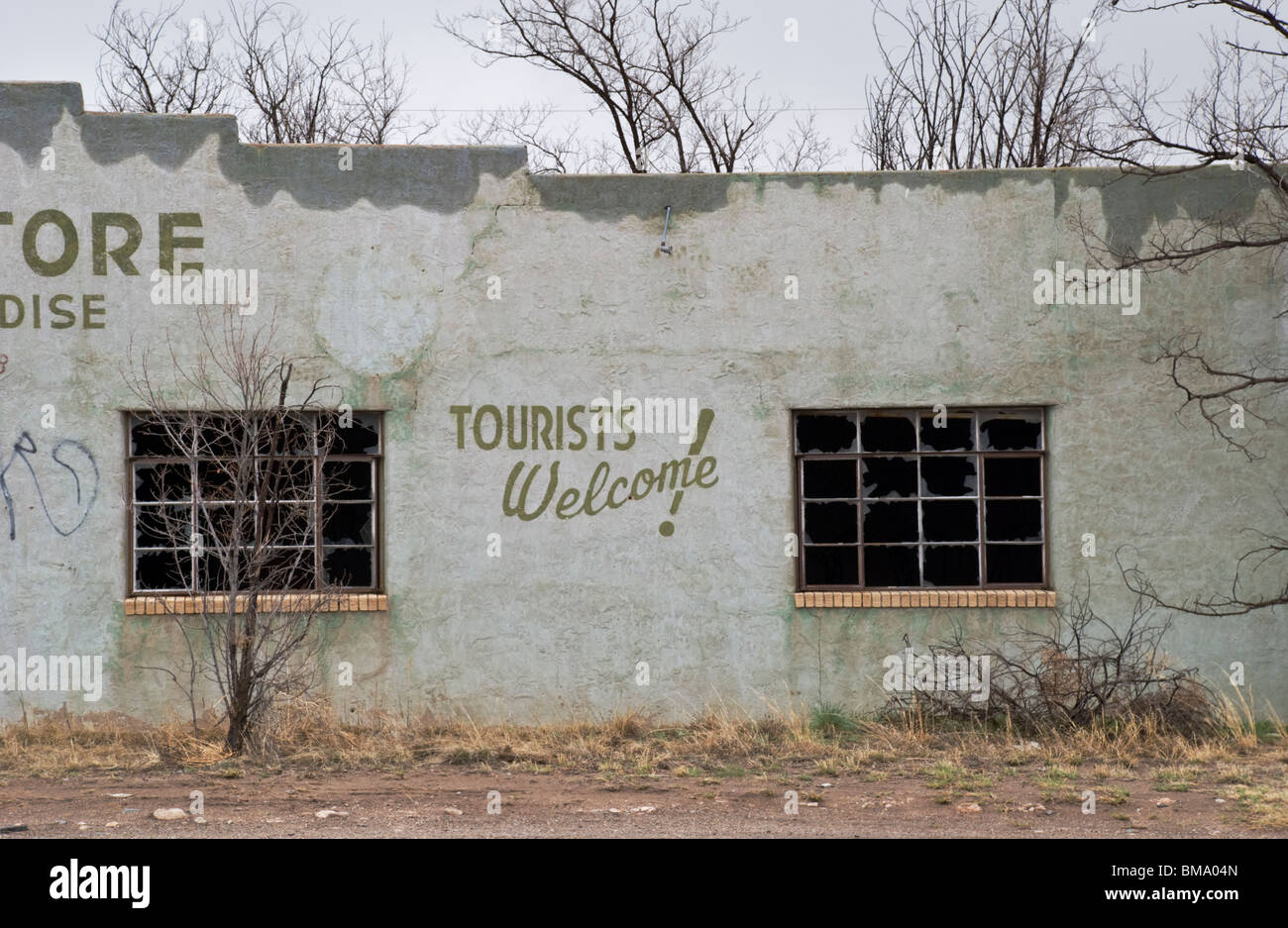 An old store front in the mostly-ghost town of Duran, New Mexico welcomes tourists as they speed by at 75mph. - Stock Image