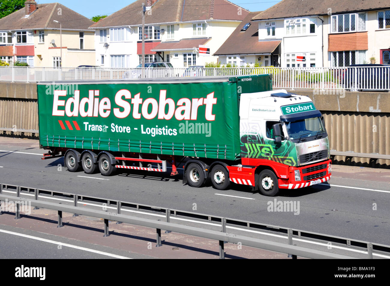 Houses close to A12 dual carriageway heavy noisy hgv road traffic with for sale sign boards - Stock Image
