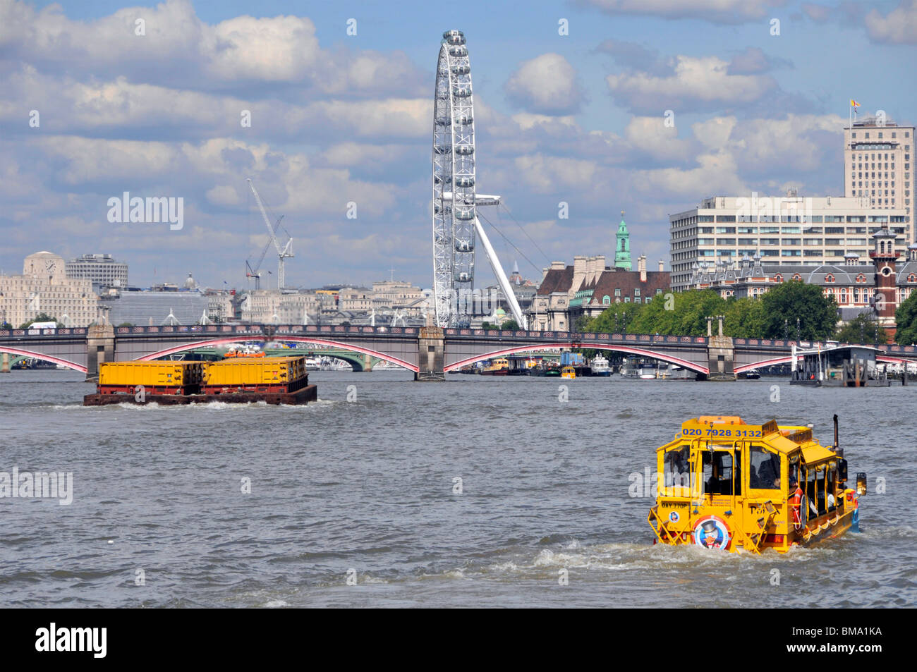 London UK business Duck Tours amphibious transport yellow sightseeing tour boat for tourist travel on River Thames - Stock Image