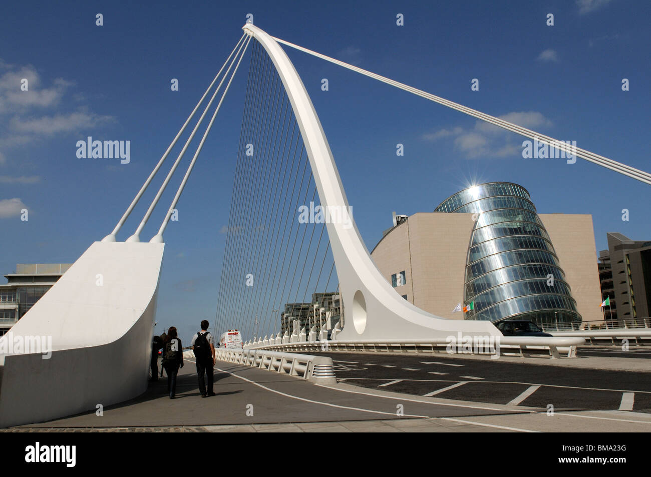 Samual Beckett Bridge over the River Liffey and the new Convention centre on Spencer Dock in the Docklands Dublin - Stock Image