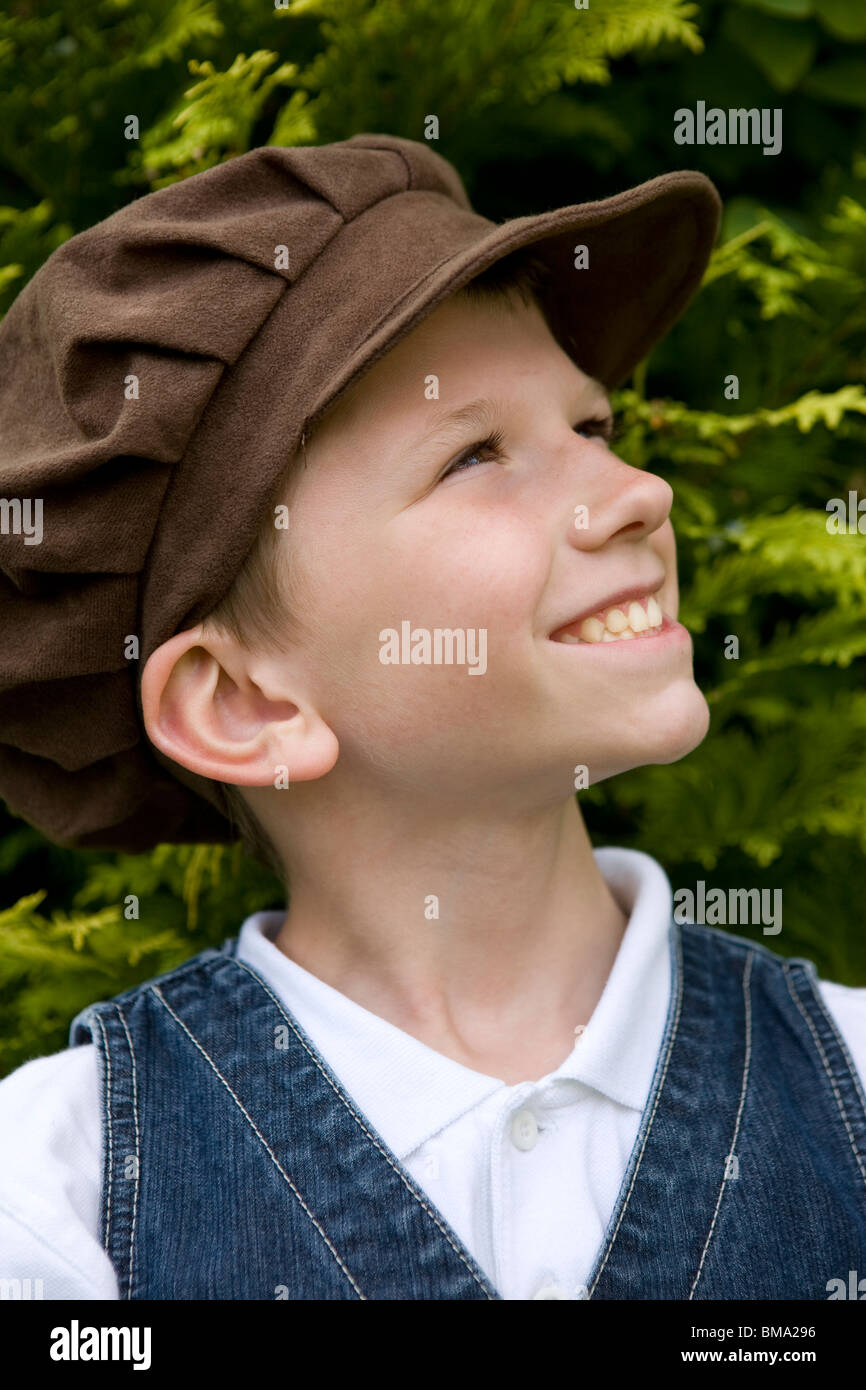 Young boy wearing Victorian clothes and an old fashioned cloth flat cap -  Stock Image 26f2fd77a1a