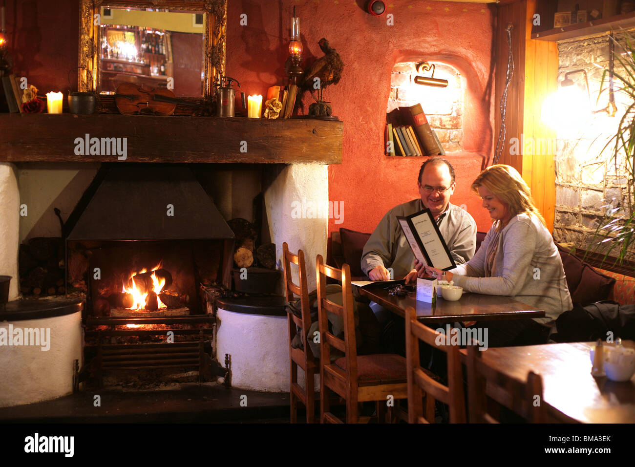 A cosy evening in a rural Irish Pub - Stock Image