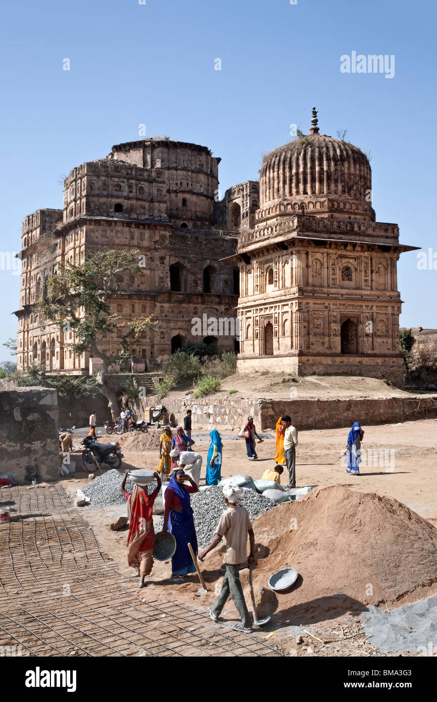 Indian workers and the Royal cenotaphs. Orchha. India - Stock Image