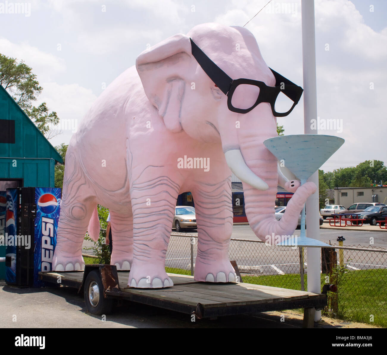 Pink Elephant drinking a martini in Fortville Indiana - Stock Image