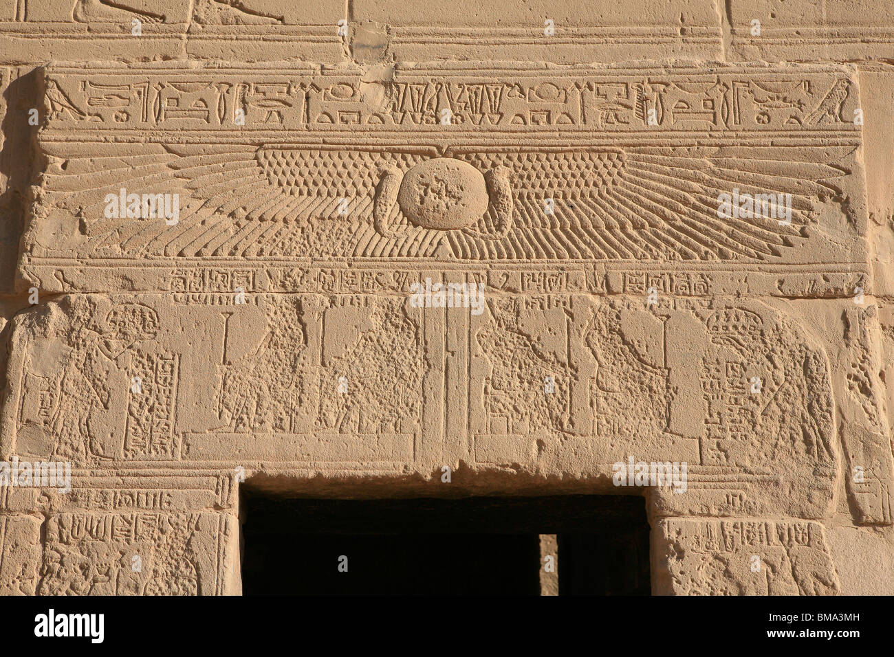 The wings of the Goddess Isis on the walls of the Temple of Philae in Egypt - Stock Image