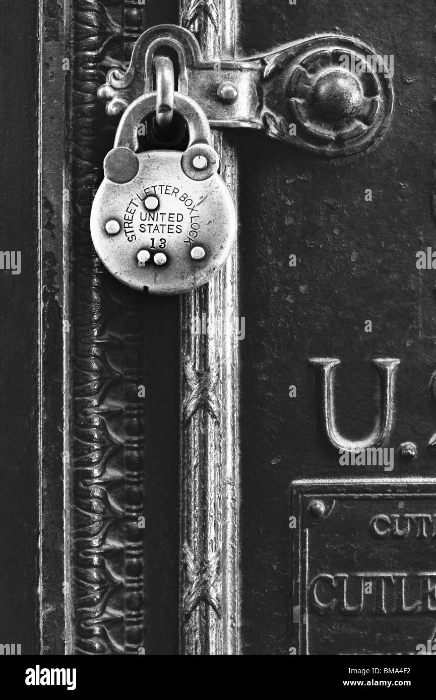 Padlock secures a postal letter box. Stock Photo