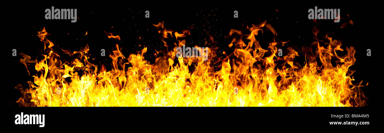 Wall of fire. On black background. - Stock Image