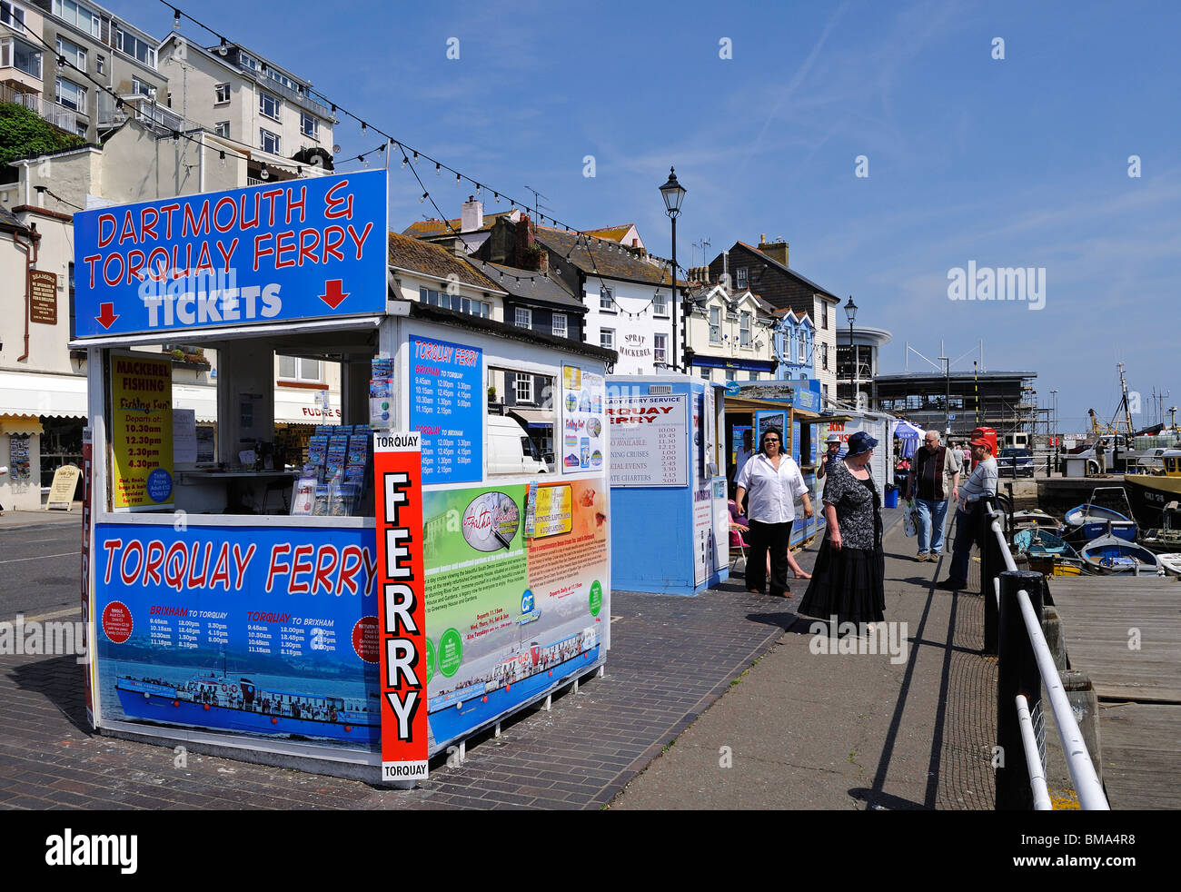 ferry ticket booths on the harbourside at brixham in devon, uk - Stock Image