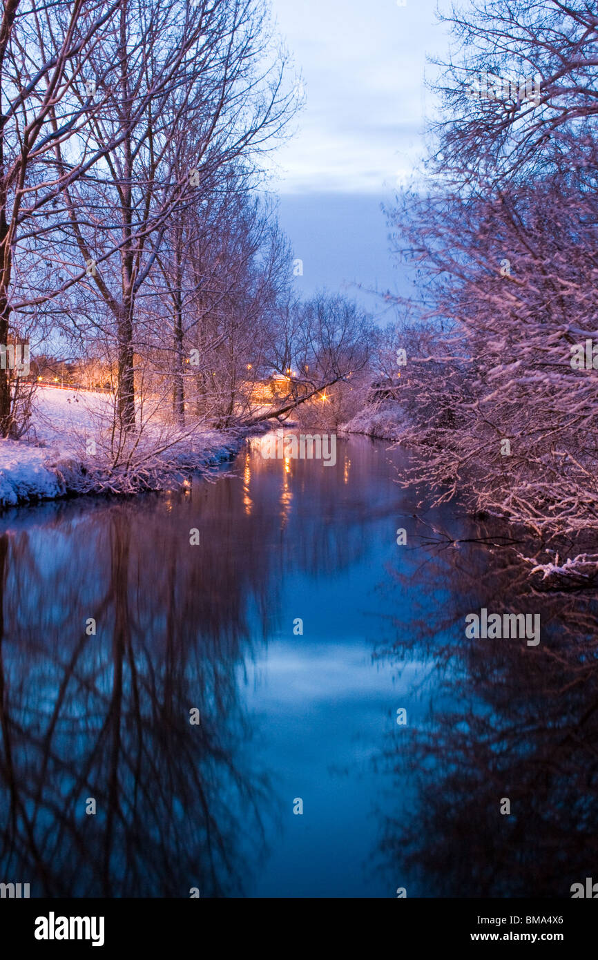 Nantwich River Weaver, Cheshire in Winter at sunrise in snow - Stock Image