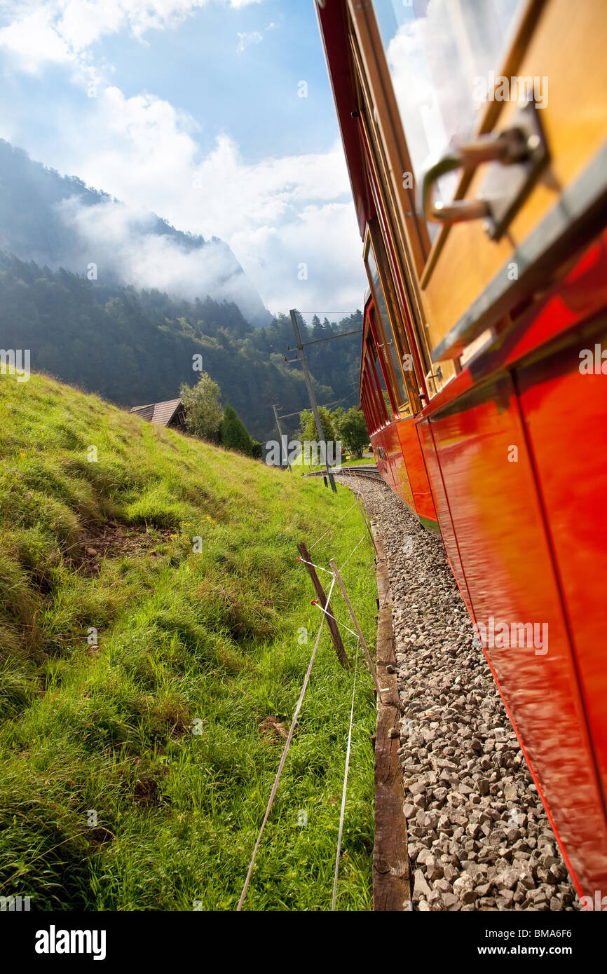 Alps mountain travel. View from the train. - Stock Image