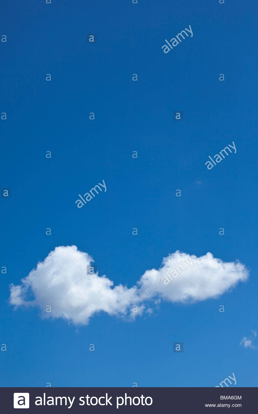 Small cumulus cloud and fresh air on a fair spring day in Toronto Ontario Canada - Stock Image