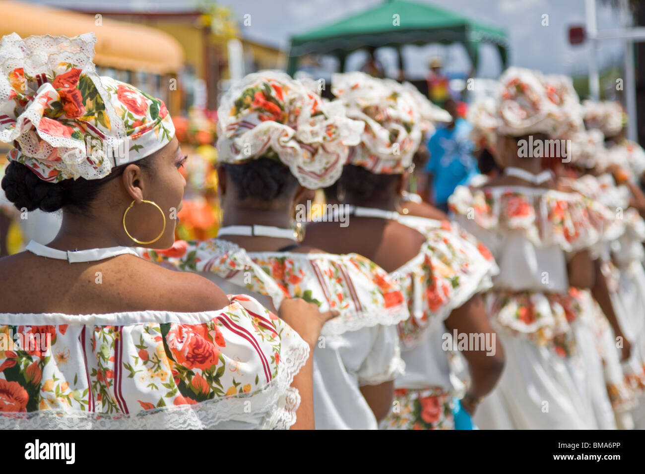 Participants dancing in Harvest Festival Parade with colorful costume, Curacao, Netherlands Antilles. Stock Photo