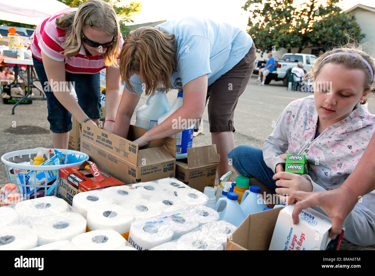 Volunteers sift through donated cleaning supplies to hand out in the Nashville suburb of Bellevue on Saturday, May - Stock Image