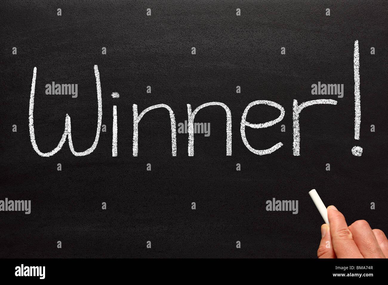 Winner, written on a blackboard. - Stock Image