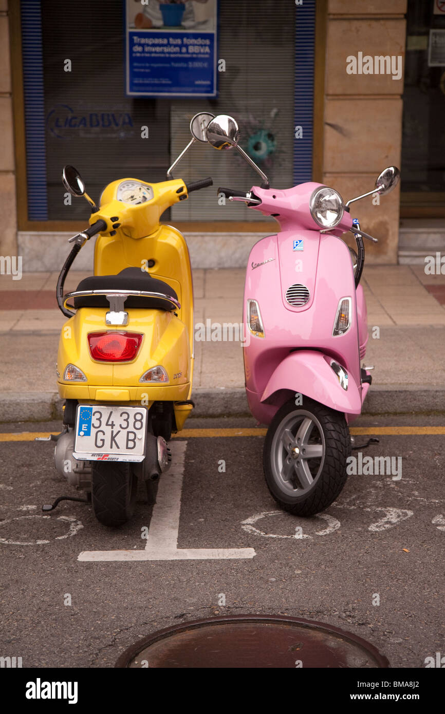 Two Vespa scooters parked in Oviedo Spain - Stock Image