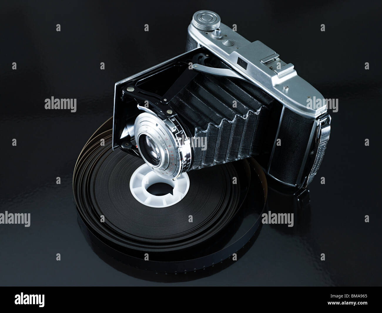 Camera and roll of film Stock Photo