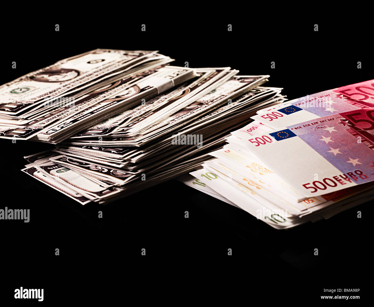 Stacks of dollars and euro banknotes - Stock Image