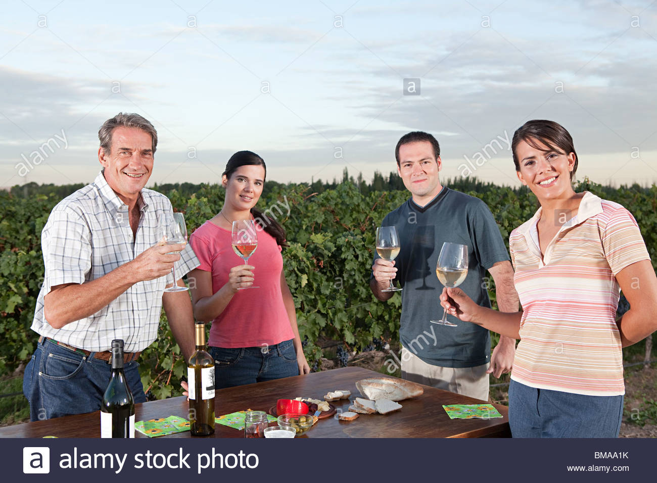 People wine tasting at vineyard - Stock Image