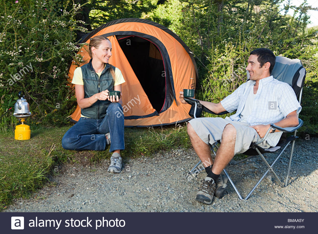 Couple camping in great outdoors - Stock Image